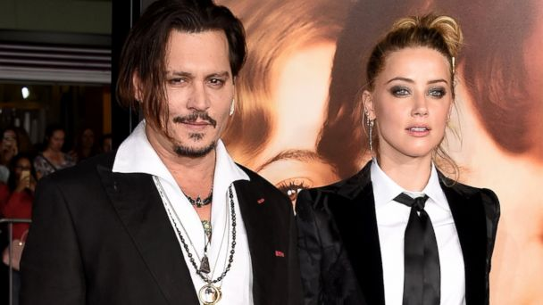 PHOTO: Johnny Depp and Amber Heard attend the premiere of Focus Features The Danish Girl at Westwood Village Theatre, Nov. 21, 2015, in Westwood, Calif.
