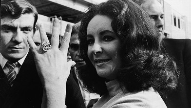PHOTO: British-born actress Elizabeth Taylor shows off the 33.19 carat diamond ring given to her by husband Richard Burton.