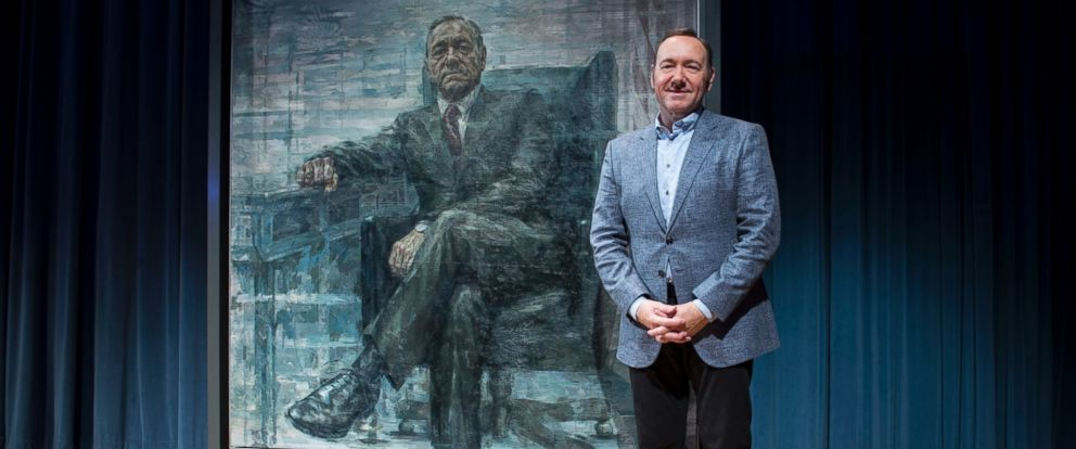 """PHOTO:Kevin Spacey poses for a photo with a portrait of his character President Frank Underwood from the series """"House of Cards""""at a press conference at the National Portrait Gallery, Feb. 22, 2016, in Washington."""