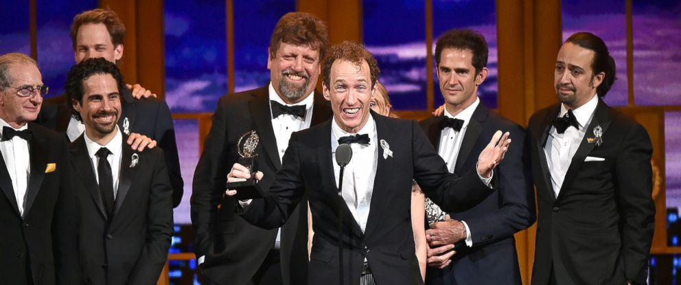 "PHOTO: Producer Jeffrey Seller accepts the Tony award for Best Musical for ""Hamilton"" onstage with his cast and creative team during the 70th Annual Tony Awards at The Beacon Theatre, June 12, 2016, in New York."