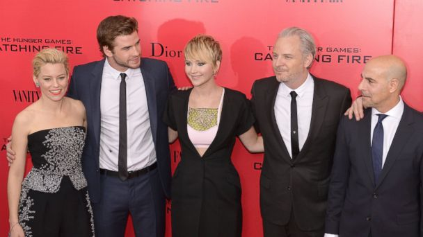 """PHOTO: Elizabeth Banks (L), Liam Hemsworth (2nd L) Jennifer Lawrence (C), director Francis Lawrence (2nd R) and Stanley Tucci (R) arrive at a special screening of """"The Hunger Games: Catching Fire"""" Nov. 20, 2013 in New York."""