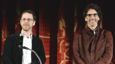 PHOTO: Writer/director Ethan Coen (L) and writer/director Joel Coen introduce the closing night gala screening of Inside Llewyn Davis at TCL Chinese Theater on Nov. 14, 2013 in Hollywood, Calif.