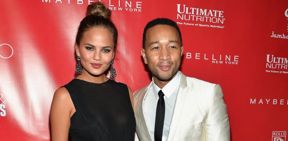 PHOTO: Chrissy Teigen, left, and John Legend, right, are pictured at the Shape & Mens Fitness kickoff party on Jan. 31, 2014 in New York City.