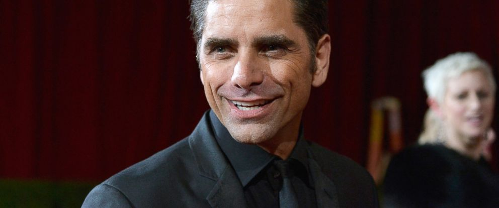 John Stamos departs the Oscars at Hollywood & Highland Center, March 2, 2014, in Hollywood.