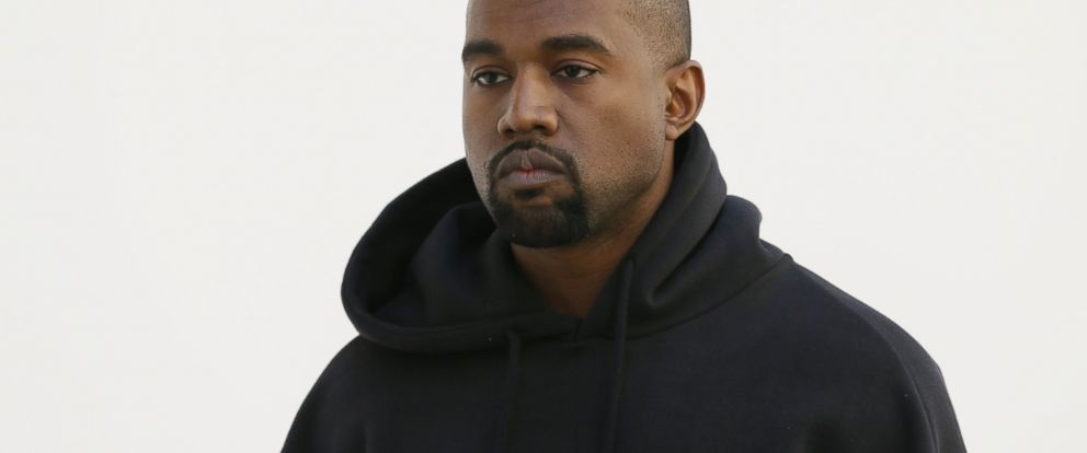PHOTO: American rapper Kanye West poses before Christian Dior 2015-2016 fall/winter ready-to-wear collection fashion show, March 6, 2015, in Paris.