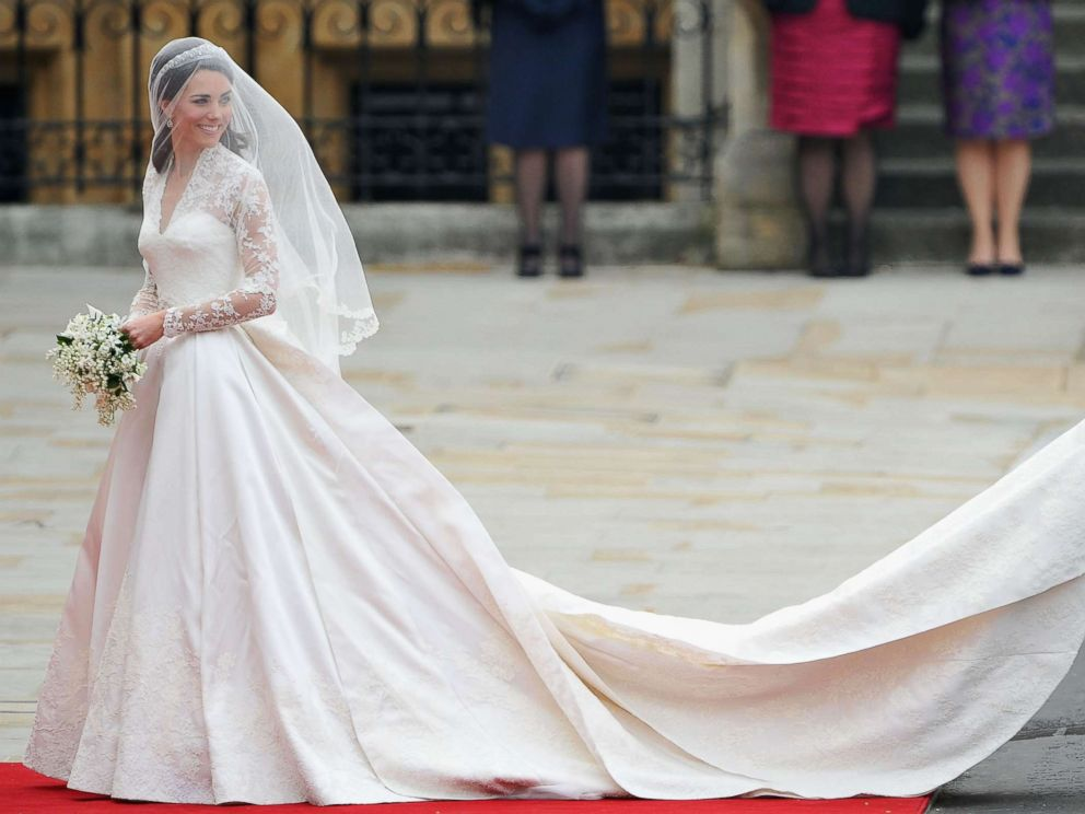 PHOTO: Catherine Middleton waves to the crowds as her sister and Maid of Honor Pippa Middleton holds her dress before walking in to the Abbey to attend the Royal Wedding of Prince William to Catherine Middleton at Westminster Abbey on April 29, 2011.