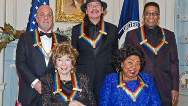 PHOTO: (L-R) Billy Joel, Shirley MacLaine, Carlos Santana, Martina Arroyo and Herbie Hancock attend the formal Artists Dinner honoring the recipients of the 2013 Kennedy Center Honors on Dec. 7, 2013 in Washington.