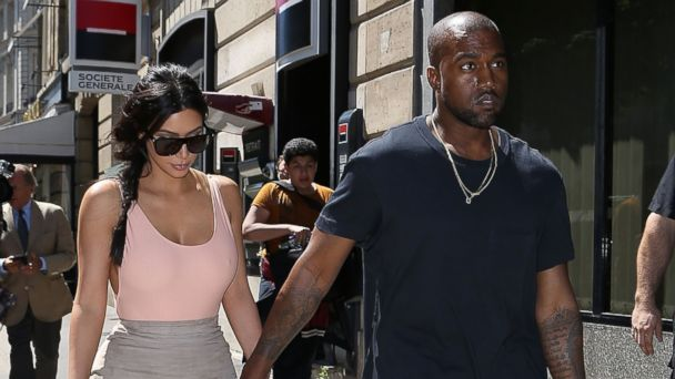 PHOTO: Kim Kardashian and Kanye West are seen strolling on the Avenue Montaigne on May 19, 2014 in Paris, France.