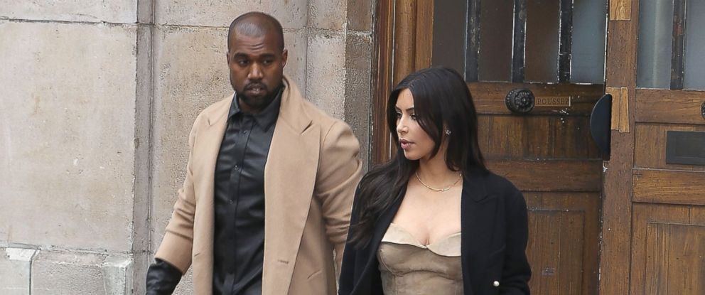 PHOTO: Kim Kardashian and Kanye West leave the Maison Martin Margiela showroom on May 21, 2014 in Paris, France.