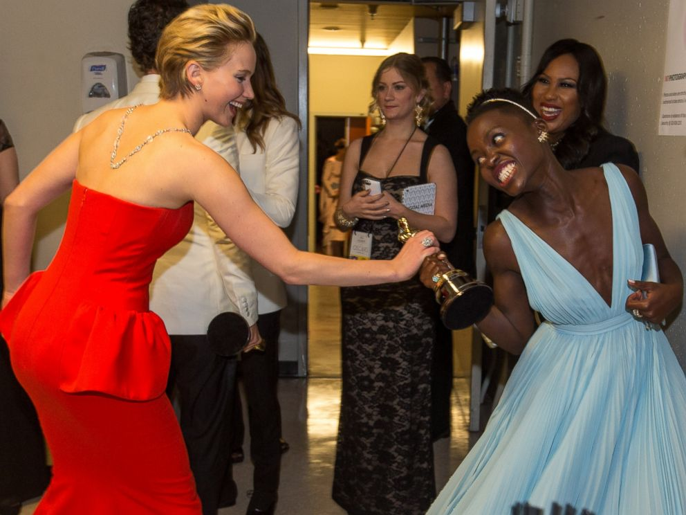 PHOTO: Jennifer Lawrence, left, is pictured with Lupita Nyongo, right, backstage during the Oscars on Mar. 2, 2014 in Hollywood, Calif.