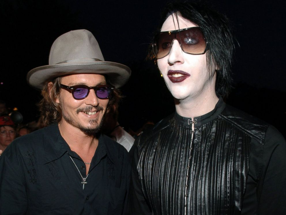 PHOTO: Johnny Depp and Marilyn Manson during Pirates of the Caribbean: Dead Mans Chest World Premiere - Red Carpet at Disneyland in Anaheim, Calif., June 24, 2006.