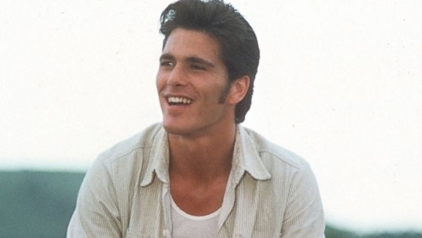 """PHOTO: Michael Schoeffling sits on a fence in a scene from the movie """"Sylvester"""" circa 1985."""