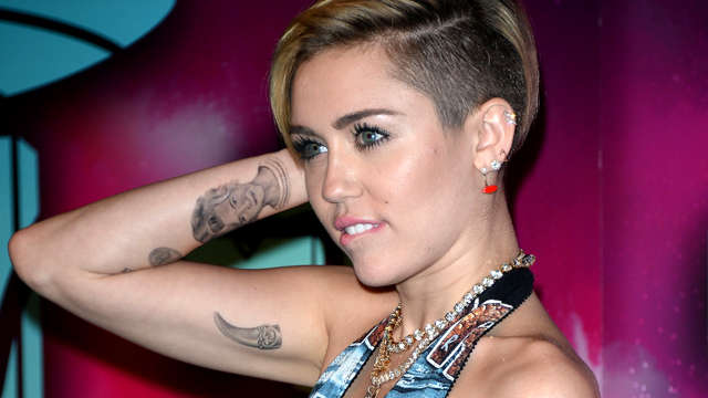 PHOTO:Miley Cyrus shows off her tattoos.