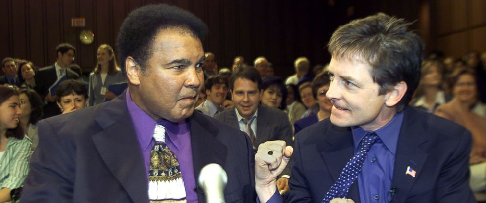 PHOTO: Boxing legend Muhammad Ali (L) and actor Michael J. Fox (R) talk before the start of a Senate subcommittee on Labor, Health, Human Services and Education hearing on Parkinsons Disease, May 22, 2002 on Capitol Hill in Washington.