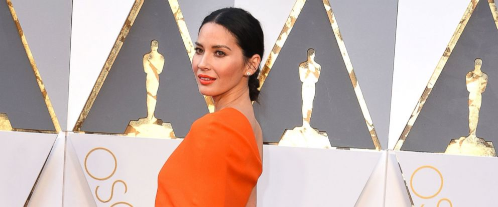 PHOTO: Olivia Munn arrives at the 88th Annual Academy Awards at Hollywood & Highland Center, Feb. 28, 2016, in Hollywood, Calif.