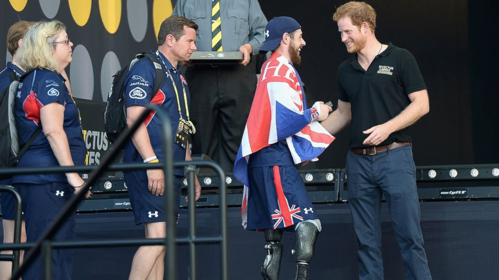 Prince Harry  greets sports competitors onstage at the Invictus Games Orlando 2016 - Closing Ceremony at ESPN Wide World of Sports Complex, May 12, 2016, in Lake Buena Vista, Fla.