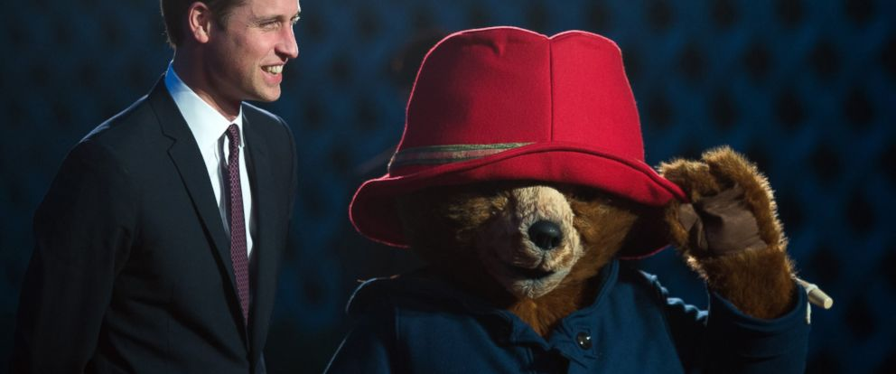 PHOTO: Britains Prince William poses next to a person wearing a Paddington bear costume prior to the screening of the Paddington movie in Shanghai, March 3, 2015.