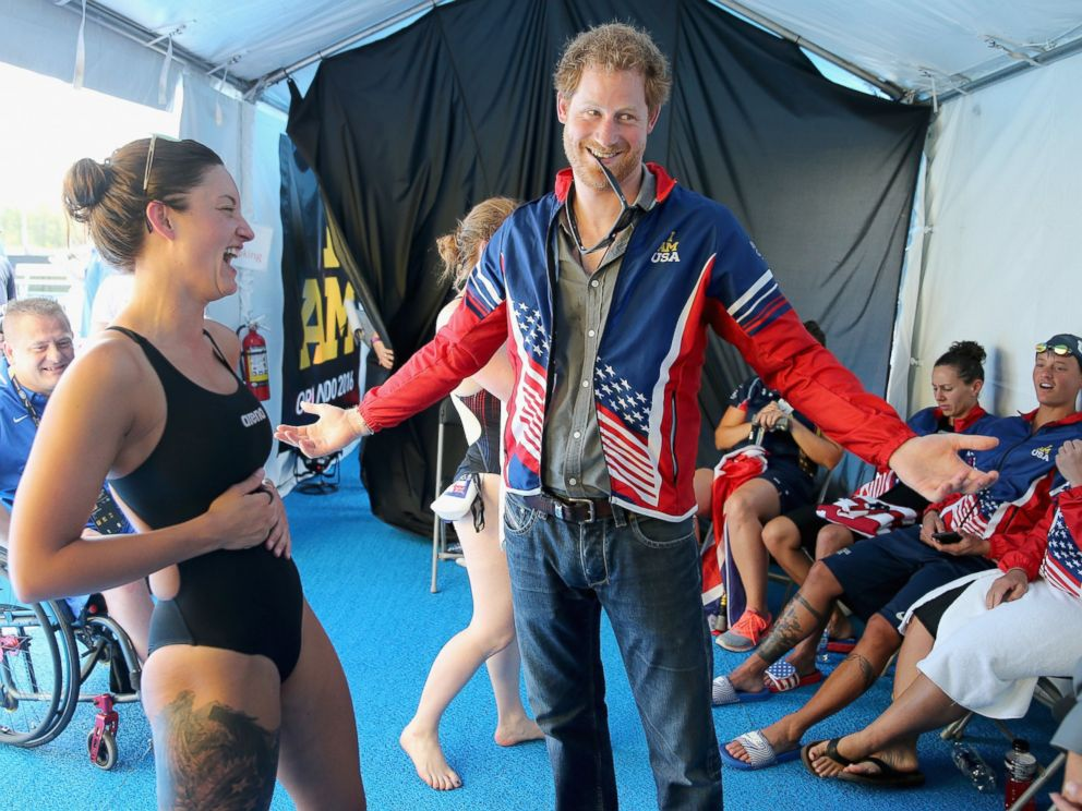 PHOTO:Prince Harry tries on USA Invictus Team Member Elizabeth Markss Team USA jersey in the competitors tent at the swimming pool during the Invictus Games Orlando 2016 at ESPN Wide World of Sports, May 11, 2016, in Orlando, Fla.