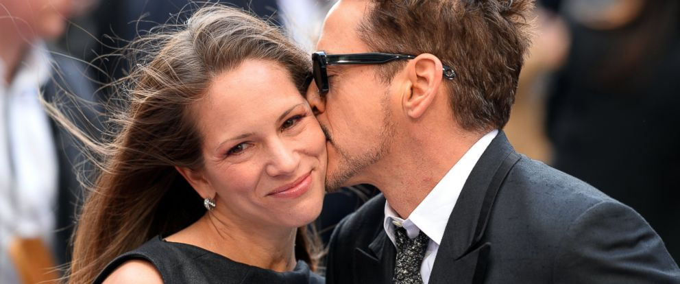 """PHOTO: Robert Downey Jr kisses his wife Susan on the red carpet as he arrives for the premiere of """"Iron Man 3"""" in Leicester Square, April 18, 2013, in London."""