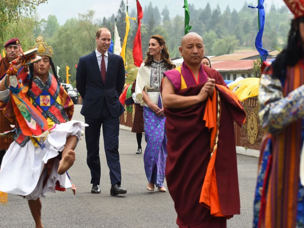 PHOTO:Prince William, Duke of Cambridge and his wife Catherine, Duchess of Cambridge follow a ceremonial procession after arriving at the Tashicho Dzong to meet the King and Queen of Bhutan in Thimphu, April 14, 2016.