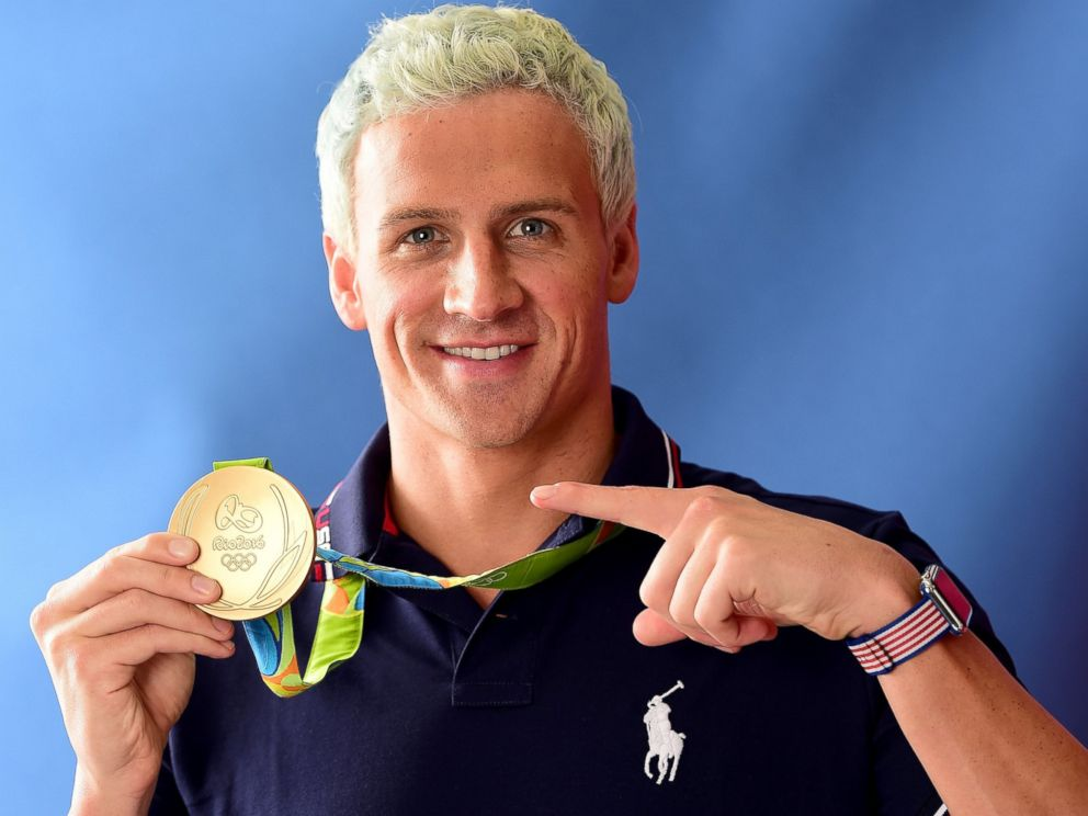 PHOTO: Swimmer, Ryan Lochte of the United States poses for a photo with his gold medal, Aug. 12, 2016, in Rio de Janeiro.