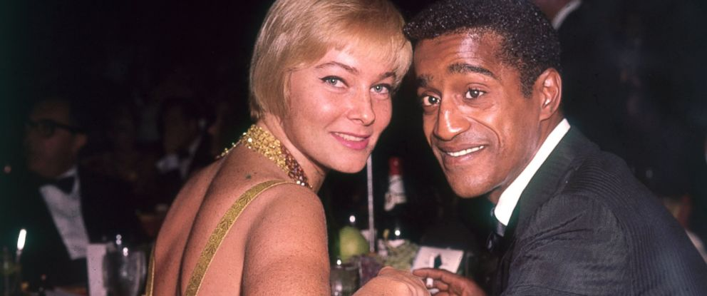 PHOTO: May Britt and Sammy Davis Jr. pose for a photo at a formal dinner, circa 1965.