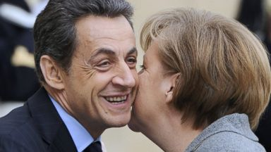 7 ways to say hello around the world abc news photo french president nicolas sarkozy kisses german chancellor angela merkel upon her arrival for m4hsunfo Choice Image