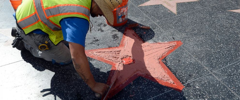 PHOTO: Donald Trumps Hollywood Walk Of Fame Star is repaired after it was vandalized, Oct. 26, 2016, in Hollywood, California.
