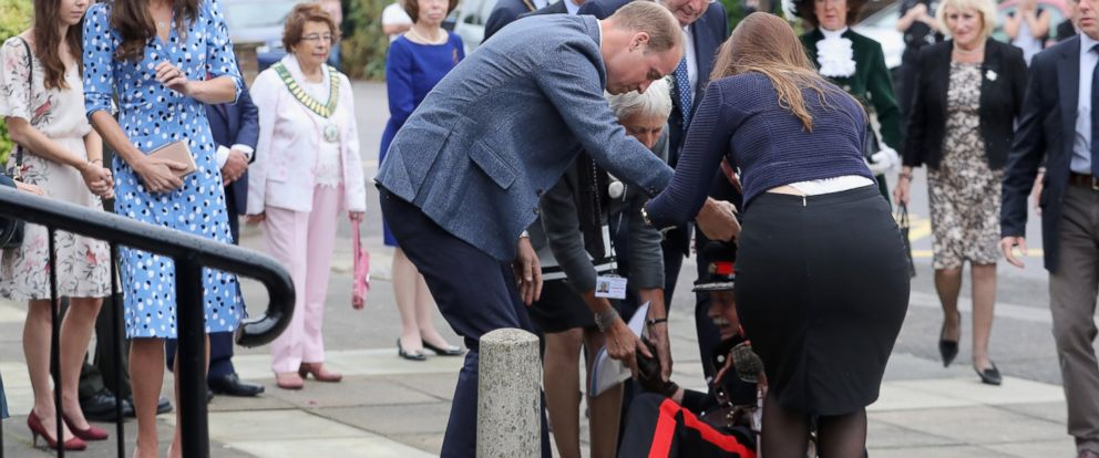 PHOTO: Catherine, Duchess of Cambridge looks on as Prince William, Duke of Cambridge helps Vice Lord Lieutenant of Essex Jonathan Douglas-Hughes who fell backwards over a bollard as they arrive at Stewards Academy, Sept. 16, 2016, in Harlow, England.