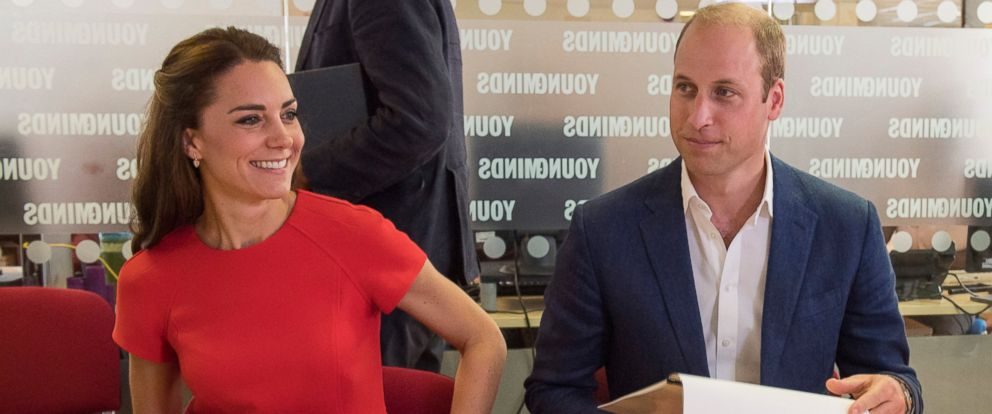 PHOTO: Catherine, Duchess of Cambridge and Prince William, Duke of Cambridge talk with staff members and volunteers during a visit to a mental health charity helpline operated by YoungMinds in London, Aug. 25, 2016.