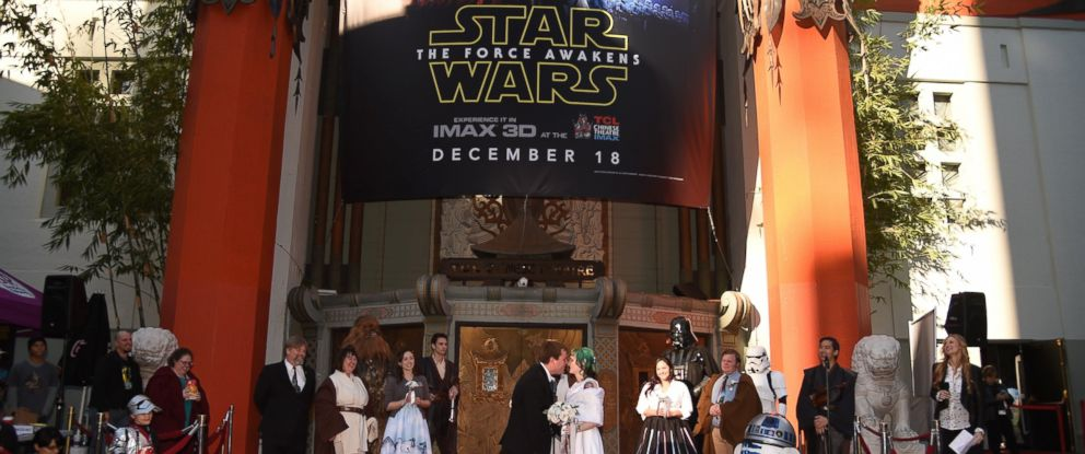 "PHOTO: ""Star Wars"" fans Caroline Ritter, 34, and Andrew Porters, 29, celebrate their marriage in a ""Star Wars""-themed wedding, in front of the Chinese Theatre, Dec. 17, 2015 in Hollywood, Calif."