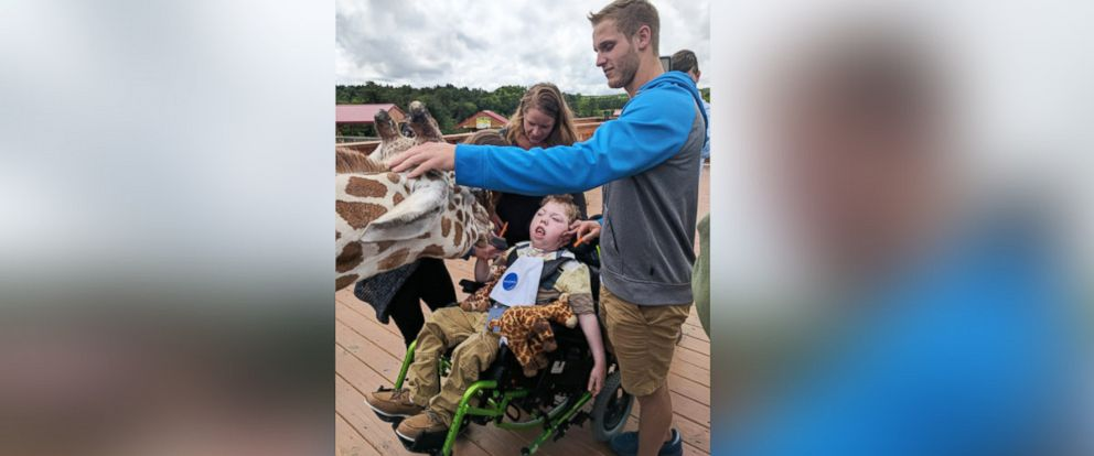 PHOTO: Alex Johnson, 11, was granted his wish by the Make-A-Wish Foundation to visit April the giraffe and her calf, Tajiri, at Animal Adventure Park.