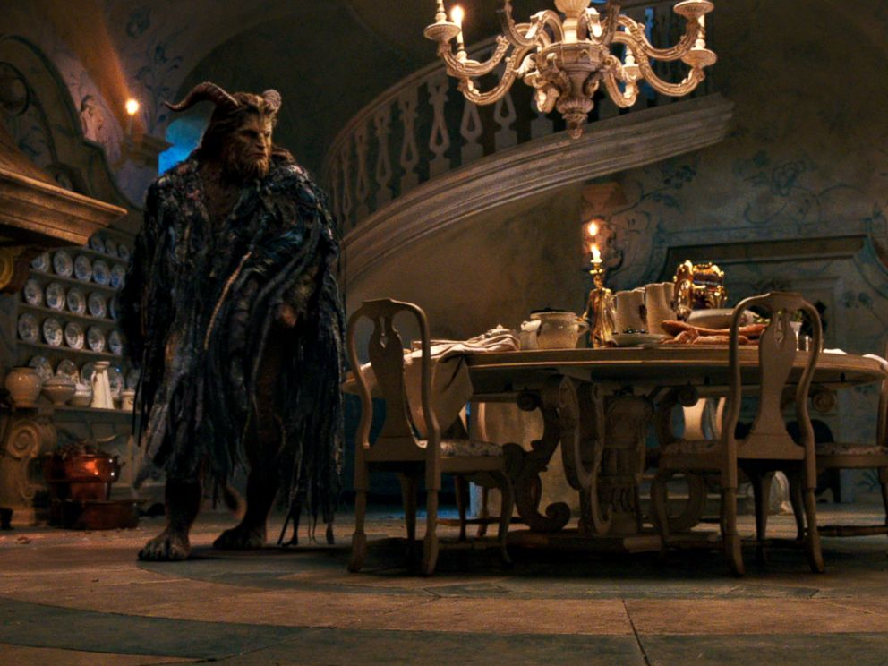 PHOTO: The Beast (Dan Stevens) with Lumiere the candelabra and Cogsworth the mantel clock in the castle kitchen in Disneys Beauty and the Beast, an adaptation of the studios animated classic.