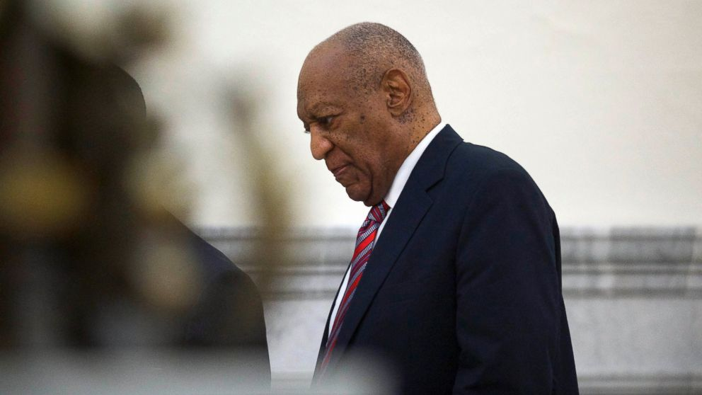 Bill Cosby walks through the Montgomery County Courthouse in Norristown, Pa., June 7, 2017, on the third day of his sexual assault trial.