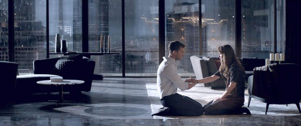 "PHOTO: Jamie Dornan, as Christian Grey, and Dakota Johnson, as Anastasia Steele, in a scene from ""Fifty Shades Darker."""