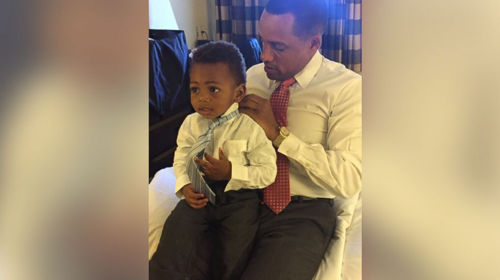Hill Harper and his son wear matching shirts to celebrate the day the adoption was finalized.