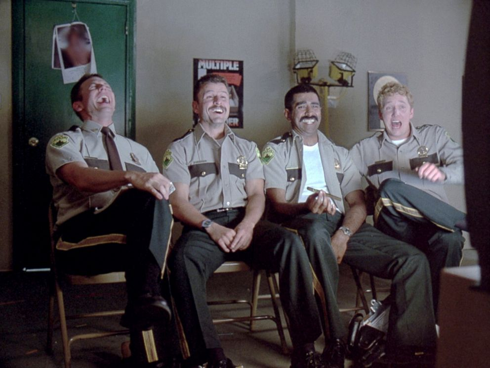 PHOTO: Cast of from the movie Super Troopers react in a scene.