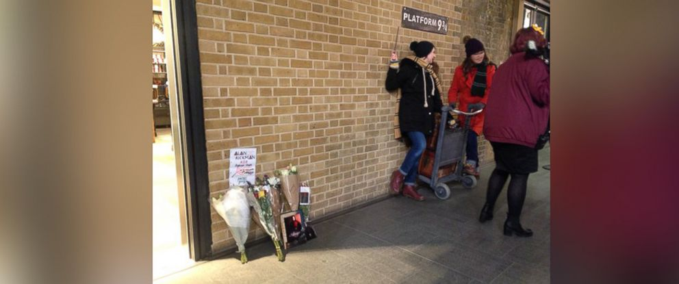 "PHOTO: ""Harry Potter"" fans pay tribute to actor Alan Rickman at the Platform 9 3/4 in Kings Cross Station in London."