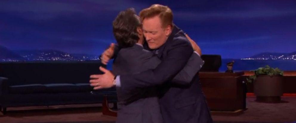 "Conan OBrien hugs his former bandleader Max Weinberg, Oct. 28, 2014 on ""Conan."""