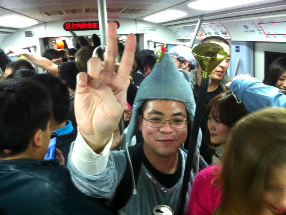 PHOTO: Commuters are seen in costume on the subway line 2 in Beijing, Nov. 1, 2013.