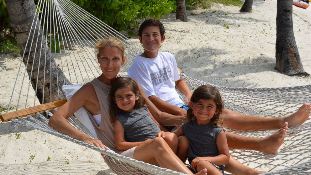 Celine Dion relaxes with her three sons, 5-year-old twins Nelson and Eddy, and 15-year-old Rene-Charles.