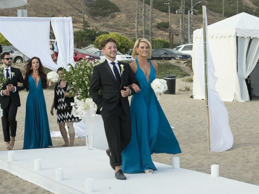 PHOTO: Bridesmaid and Dancing With the Stars pro Peta Murgatroyd walks down the aisle.
