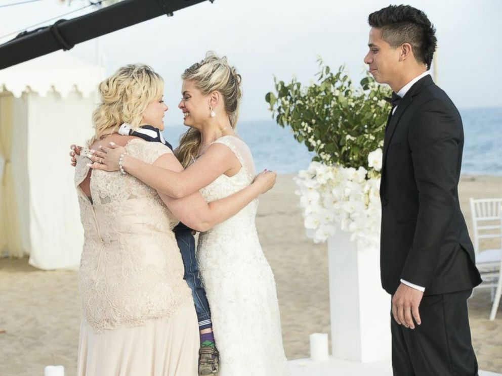 PHOTO: Bride Oksana Dmytrenko reunites with her mother, Inna, after not seeing her for six years.