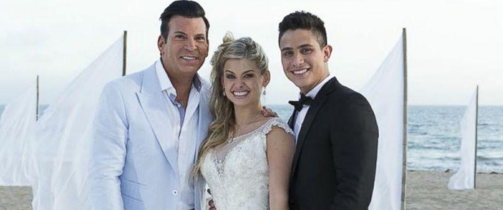PHOTO: Celebrity event planner David Tutera with the couple, Oksana Dmytrenko and Jonathan Platero.