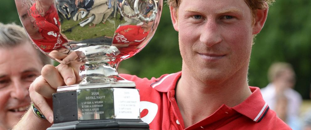 PHOTO: Prince Harry hoists the Hackett Rundle Cup after winning it on Saturday, July 12, 2014.