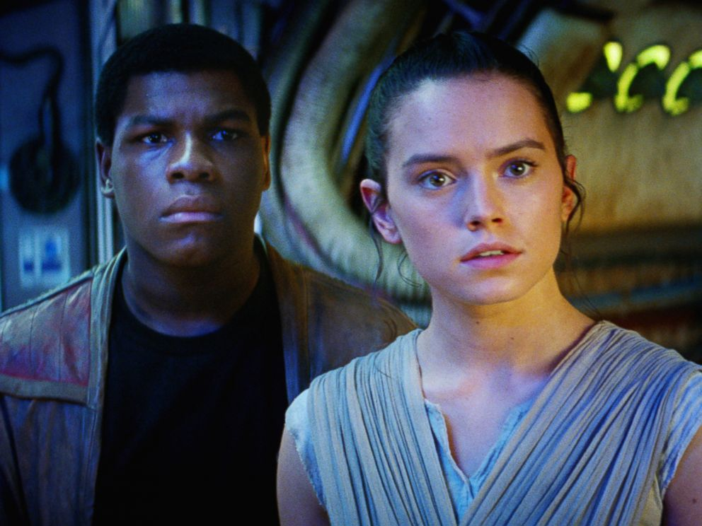 PHOTO:John Boyega as Finn and Daisy Ridley as Rey in a scene from Star Wars: The Force Awakens.