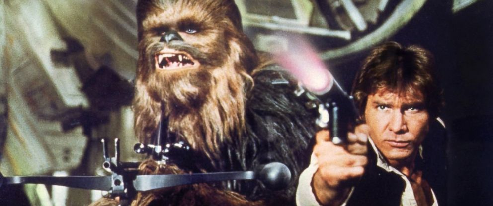 """PHOTO: Peter Mayhew, left, as Chewbacca and Harrison Ford as Han Solo in a scene from """"Star Wars: Episode IV - A New Hope."""""""