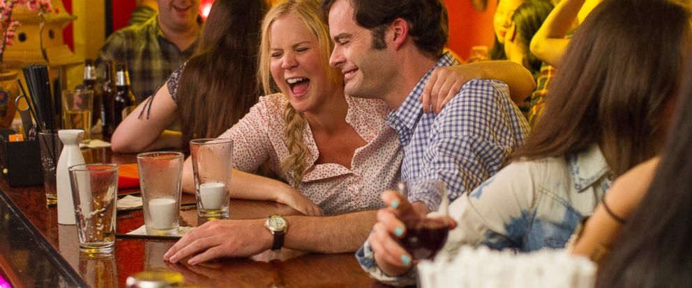 """PHOTO: Amy Schumer, as Amy on a date with Aaron, played by Bill Hader, in the new comedy, """"Trainwreck."""""""