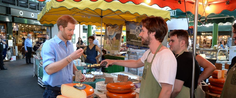PHOTO: Prince Harry trying some cheese during a visit to Borough Market in London, which has opened yesterday for the first time since the London Bridge terrorist attack, June 15, 2017.