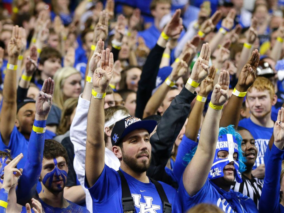 PHOTO: The eRupption zone , UKs student section, salutes Josh Hutcherson with a symbol from the Hunger Games as Kentucky defeats Louisville 73-66 on Dec. 28, 2013 in Lexington, Ky.